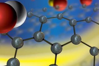 The grey spheres represent carbon atoms in the graphene, which protects the photocathode from gases in the environment.