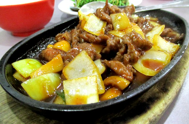 Sizzling beef on a hot plate