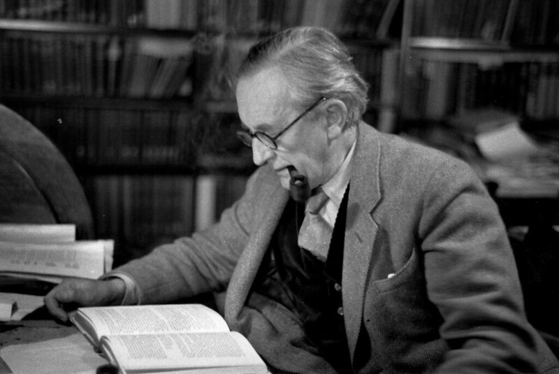 J.R.R. Tolkien (1892 - 1973) reading in his study. © Haywood Magee/Getty Images
