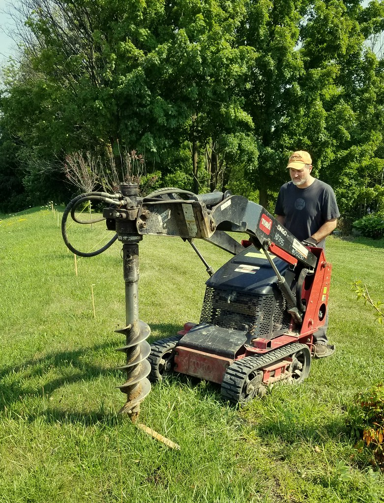 mini skid-steer with auger