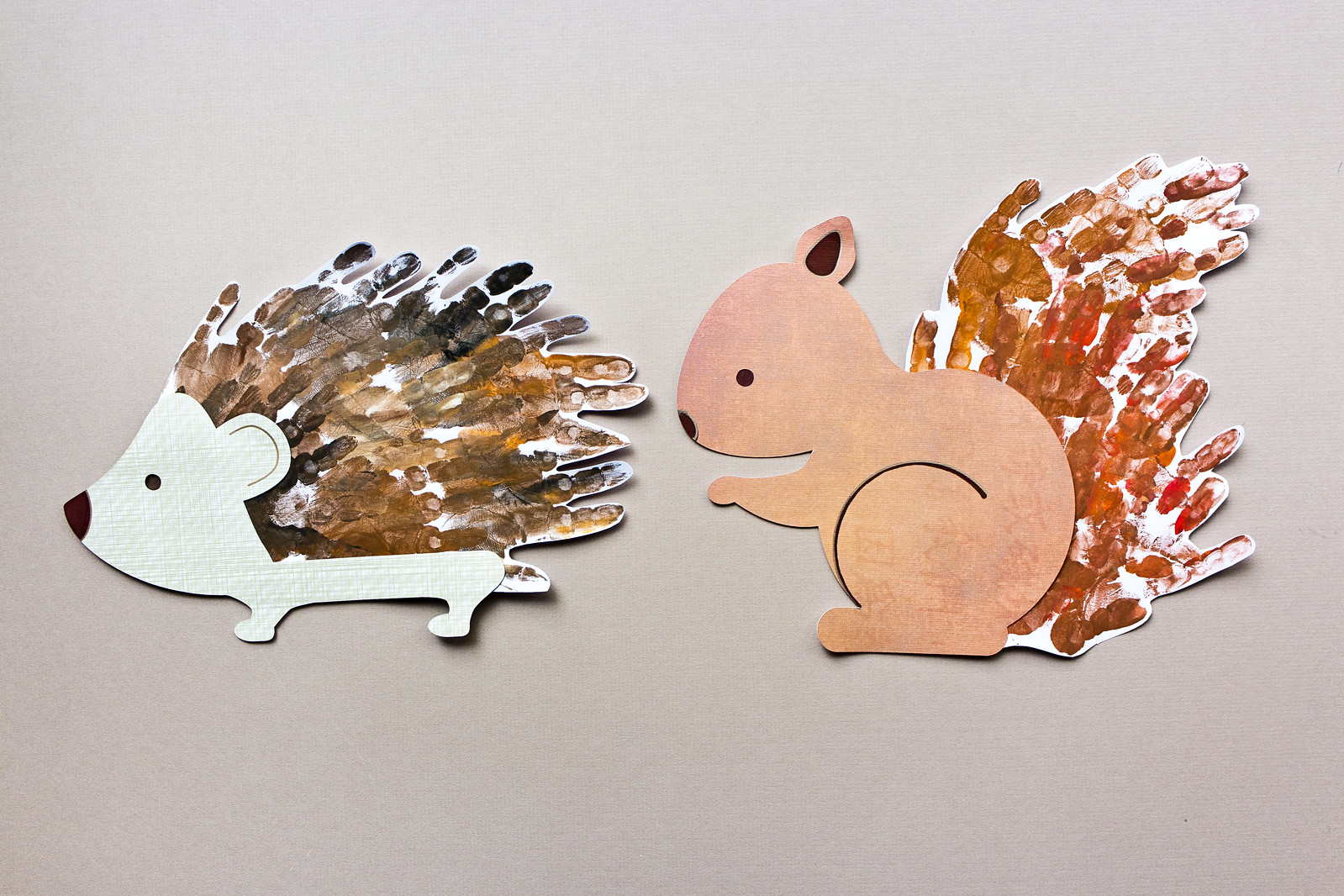 Handprint hedgehog and squirrel art activity for toddlers, with free PDF download for cutting by hand and free svg for cutting machines