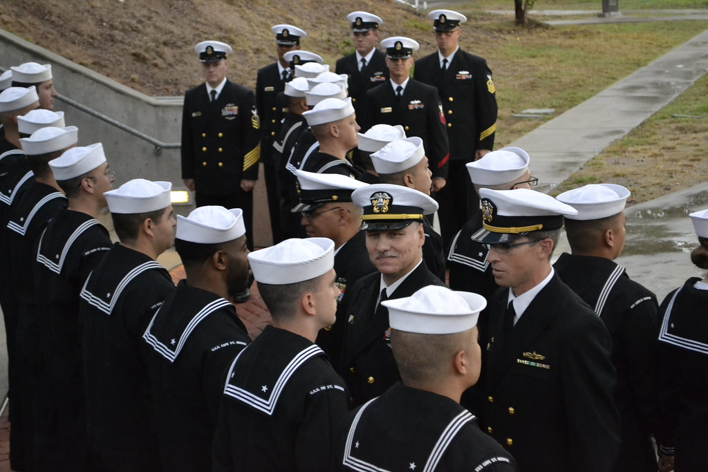 CG-71 Commanding Officer, Lieutenant Commander Erik S. Reynolds, conducts personnel inspection and wards presentation during an All Hands Call on October 5th.