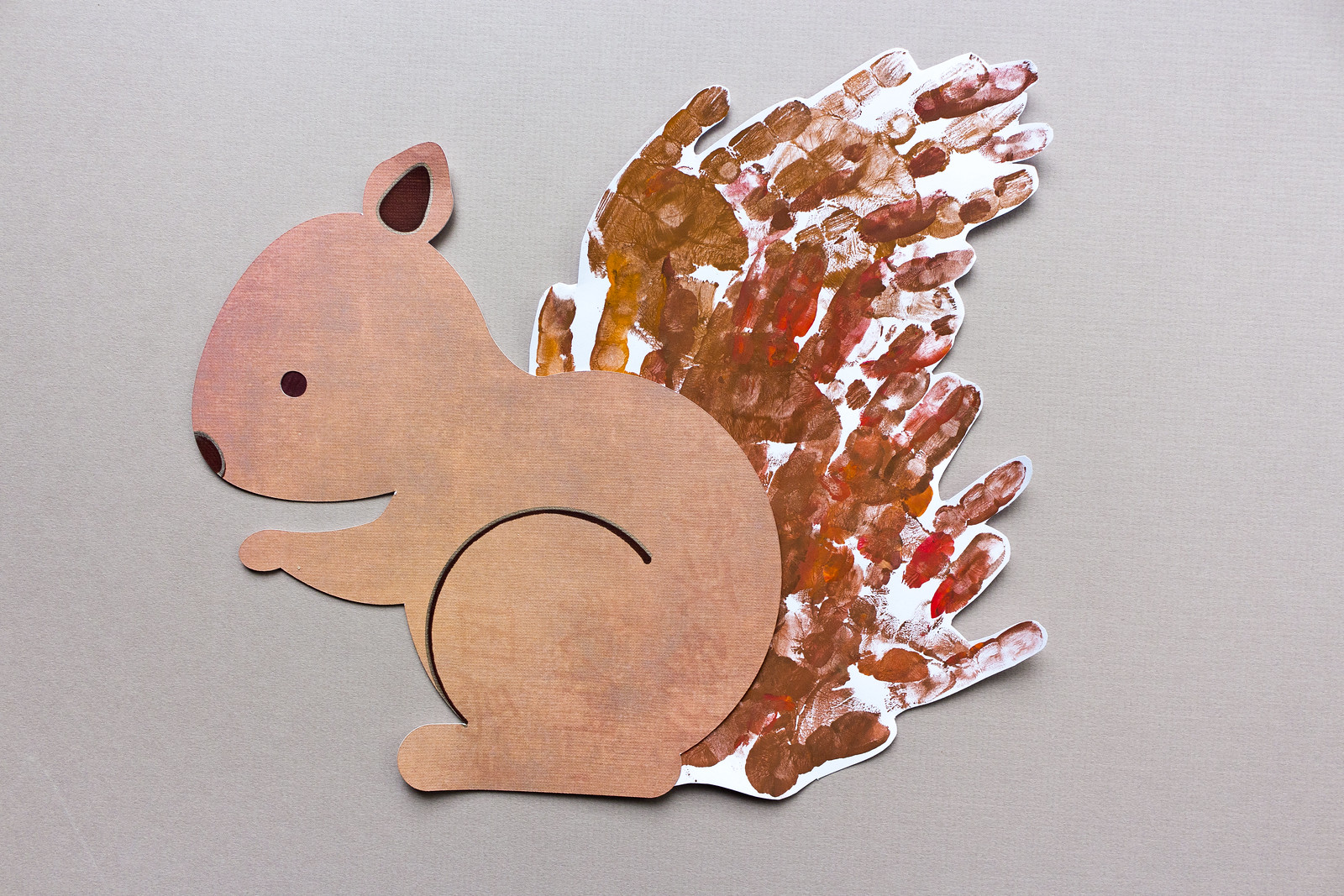 Handprint squirrel for a toddler and child activity. Free PDF and SVG files for hand or machine cutting are included.