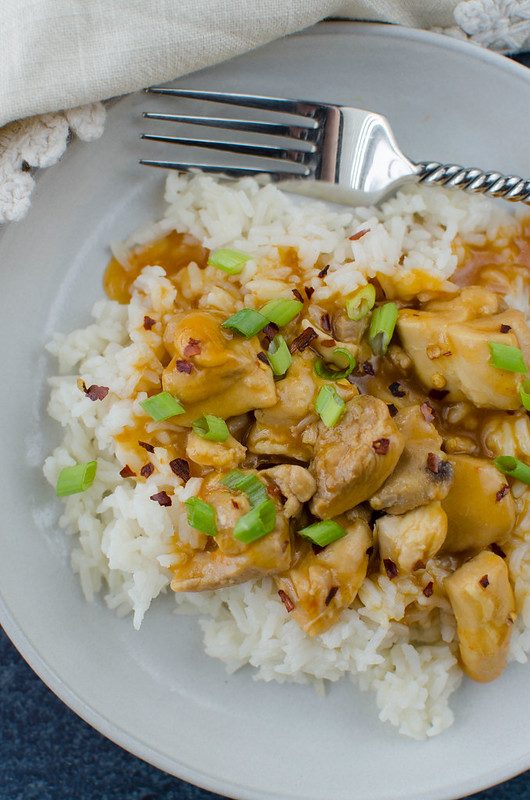 Pressure Cooker Orange Chicken - takeout taste in 15 minutes! Chicken thighs are cooked in a sweet and spicy orange sauce and served over rice for a kid-friendly, weeknight meal!