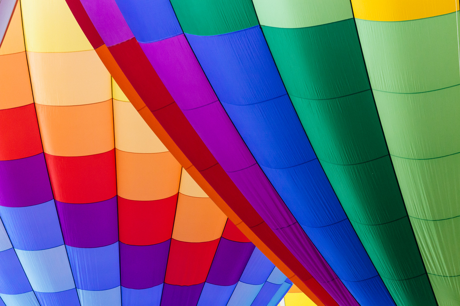Rainbow-colored hot-air balloons at the Albuquerque International Balloon Fiesta