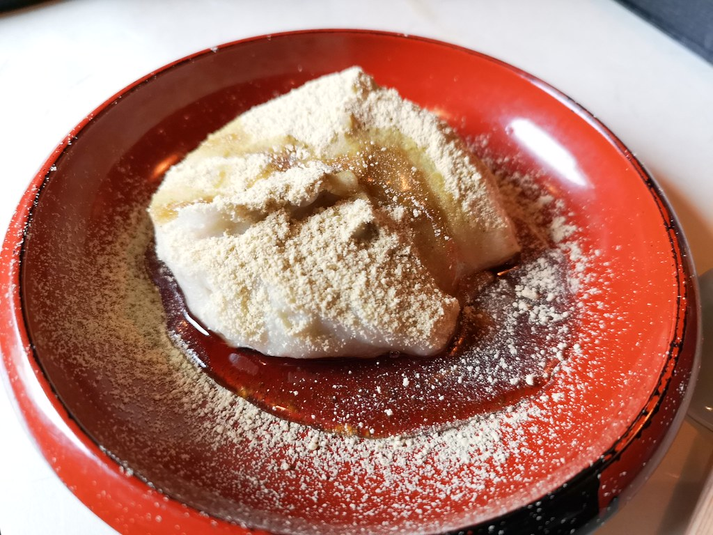 This is a regional dish not easily available elsewhere, I think. It comes in sweet or savoury form. This is the sweet version, drizzled with honey and dusted with soy bean powder.
