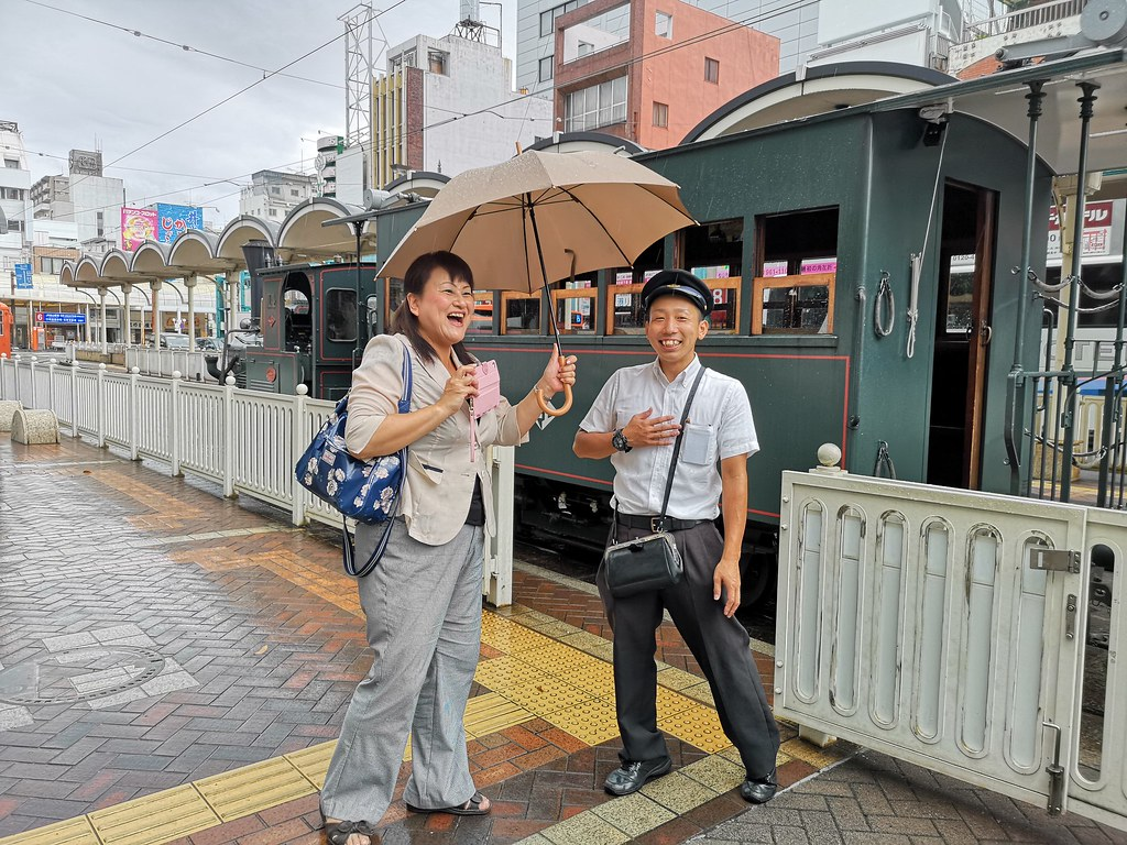 Our guide Lily-san and the conductor share a good laugh. You can see his smart uniform better here. Love that handbag!
