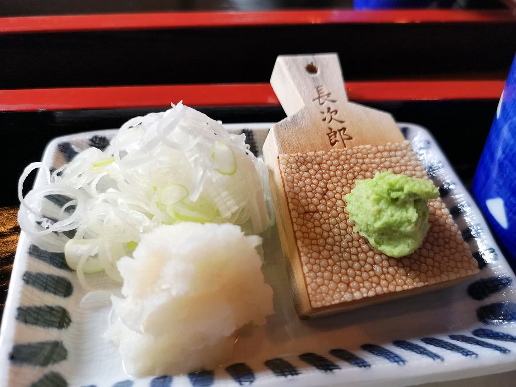 Freshly grated wasabi, grated daikon and julienned scallions are indispensable accompaniments to a serving of cold soba.