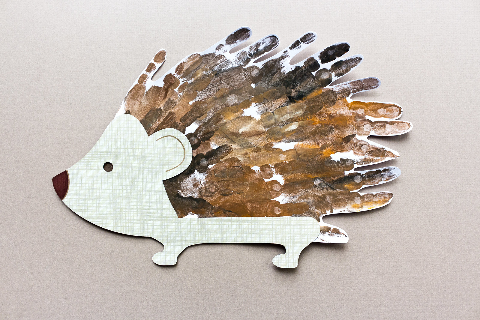Toddler handprint hedgehog with free downloadable PDF and SVG files for cutting by hand or machine
