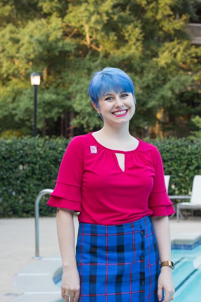 Bright Blue Pixie Cut with Ruffle Sleeve Pink Shirt