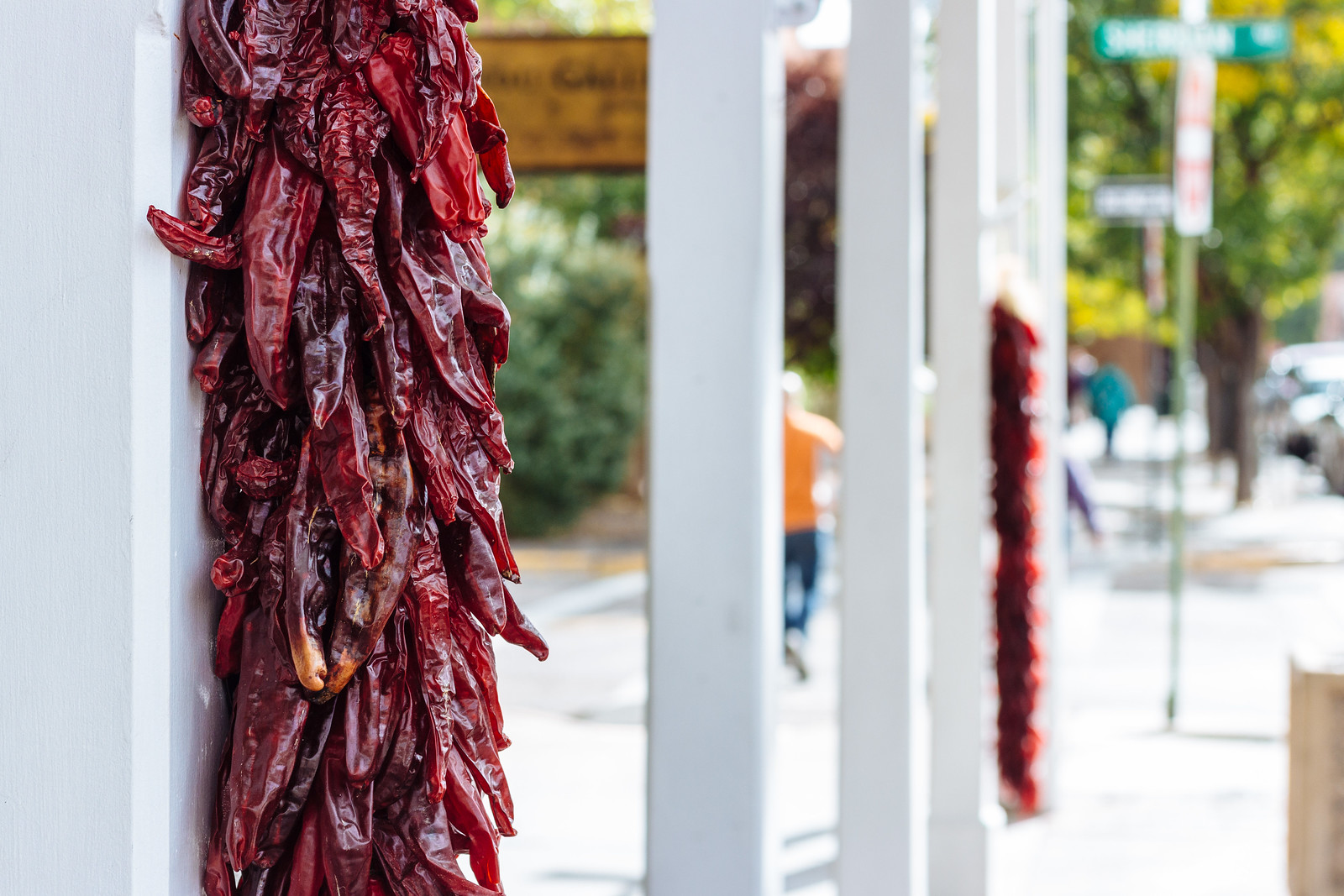 Hanging bunches of red chile peppers in Santa Fe, New Mexico