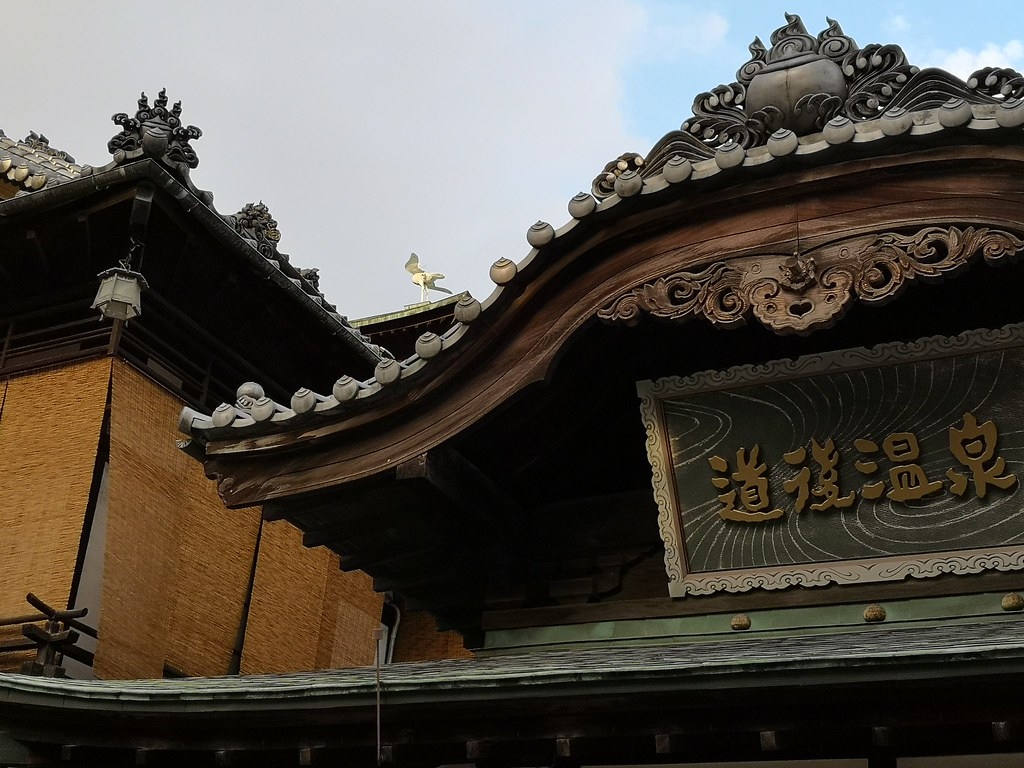The sculpture of a white heron sits atop the highest point of the Dogo Onsen Main Building.