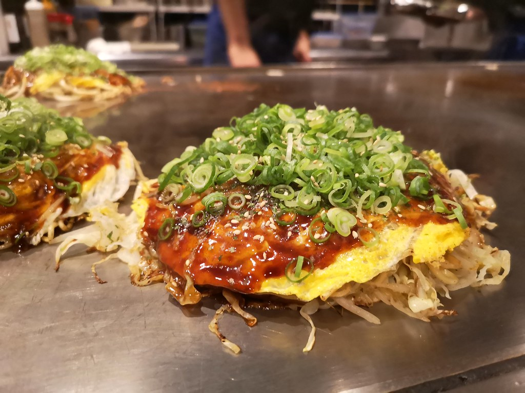 A Hiroshima-style okonomiyaki comprises about 11 alternating layers of carbs, protein and some vegetables.