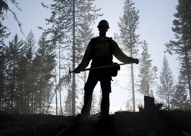 A firefighter in silhouette
