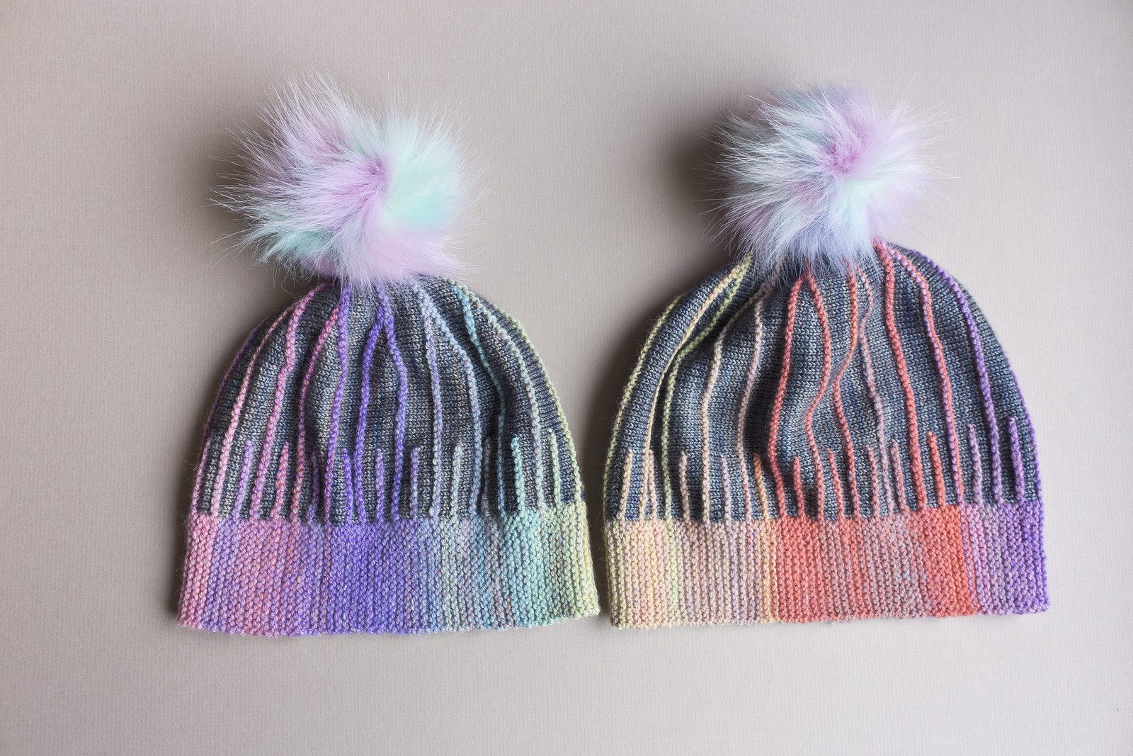 Two Misura hats knit by Mimi Codd from a Woolly Wormhead pattern, knit sideways from handspun