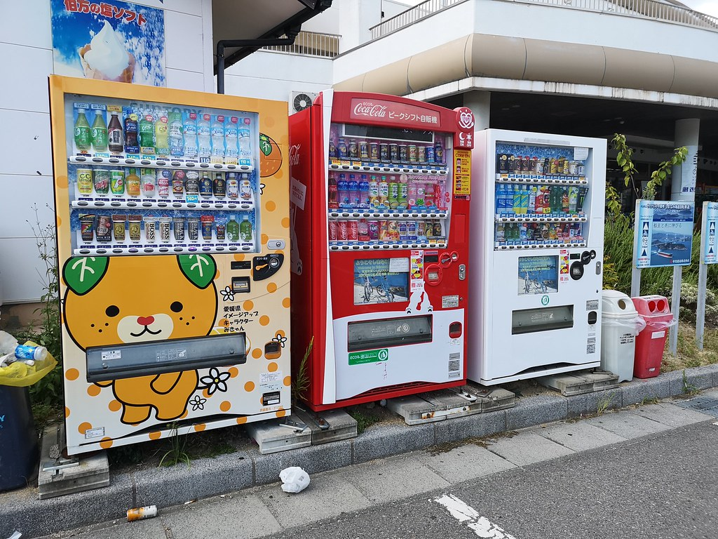 Ehime's local mascot Mikyan is prominently featured on the vending machine.