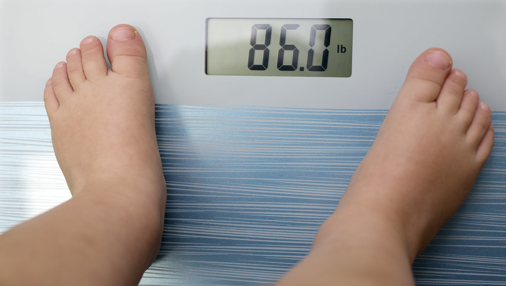 Child legs on scales