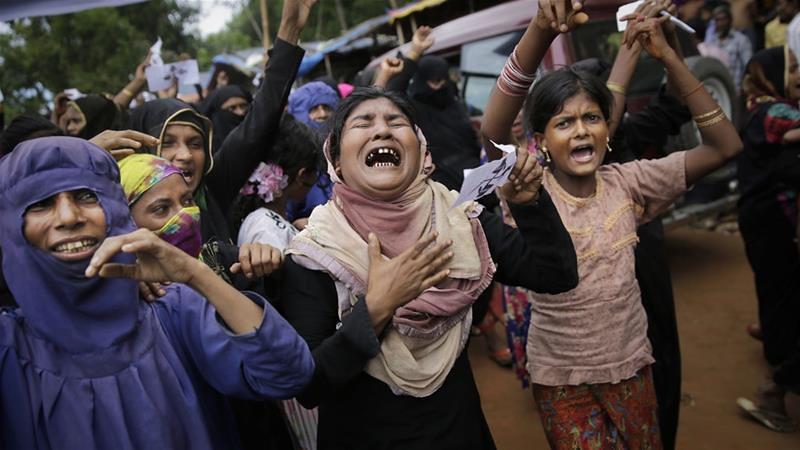 羅興亞婦女在軍事鎮壓一週年之際哭泣。(圖片來源:Altaf Qadri/AP)
