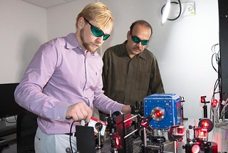 Los Alamos scientists Alexander Malyzhenkov and Alonso Castro demonstrate levitating uranium particles with laser beams.