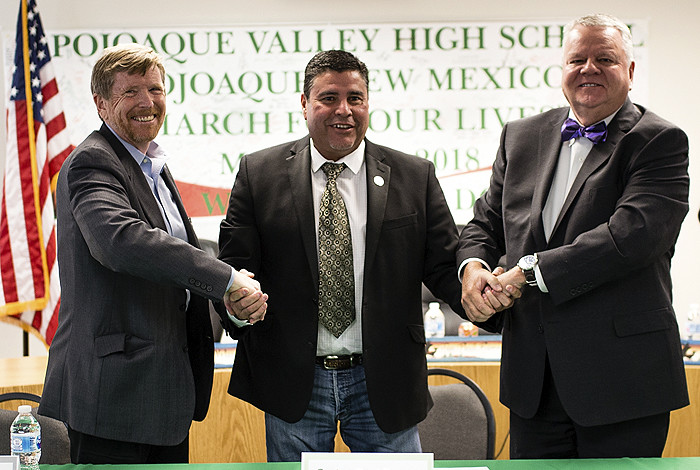 Terry Wallace, Jon Paul Romero and Sam Minner standing shaking hands