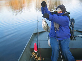 Photo of woman catching a crappie