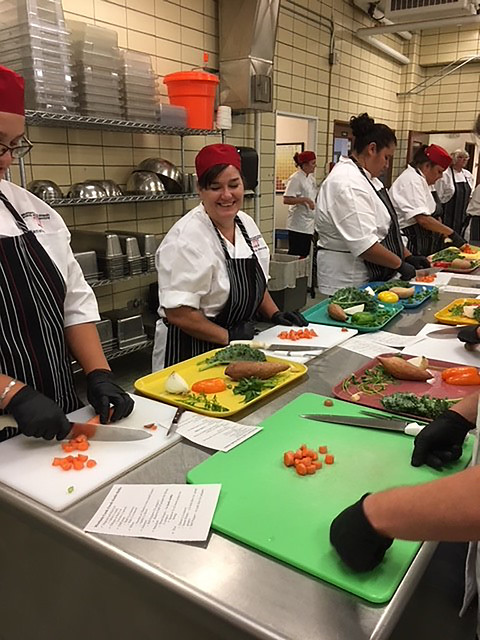 Participants learning scratch cooking and knife skills at Montana school nutrition training
