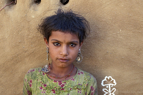 Portrait of young girl with earrings. India | by World Bank Photo Collection