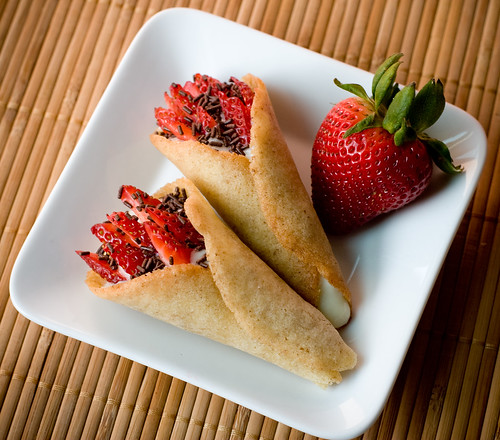 Tuile Cones with Almond Pudding and Strawberries | by teenytinyturkey