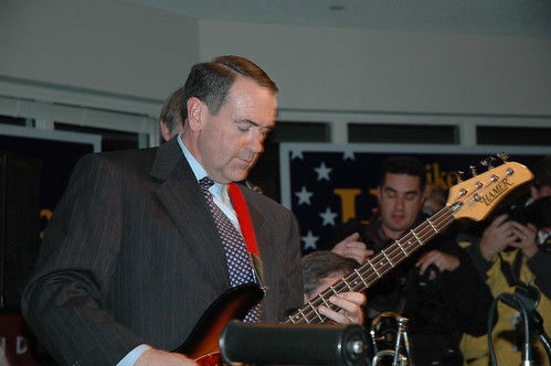 Mike Huckabee jams on his bass guitar New Year's Eve 2007 | by WEBN-TV