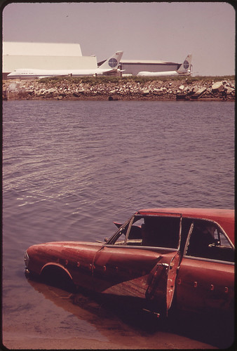 Among the Shoreline Debris at the John F. Kennedy Airport Is This Abandoned Auto 05/1973 | by The U.S. National Archives