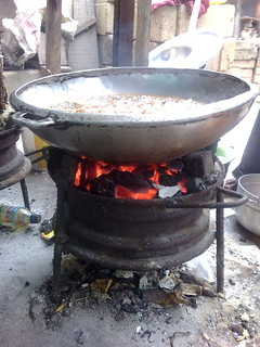 Open Flame Cooking Innovation: Using a Wheel Rim to hold coals near pan or pot | by Wayan Vota