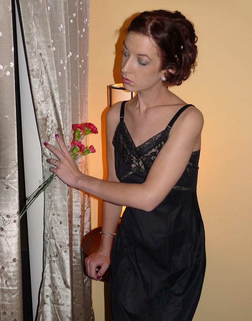 Marla bedroom shot model marla in a black slip peering th