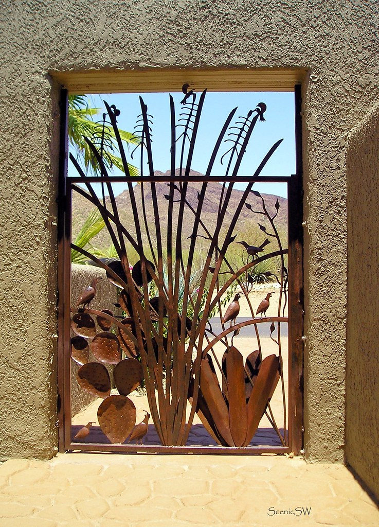 Mountain Gateway Looking Through A Decorative Gate To