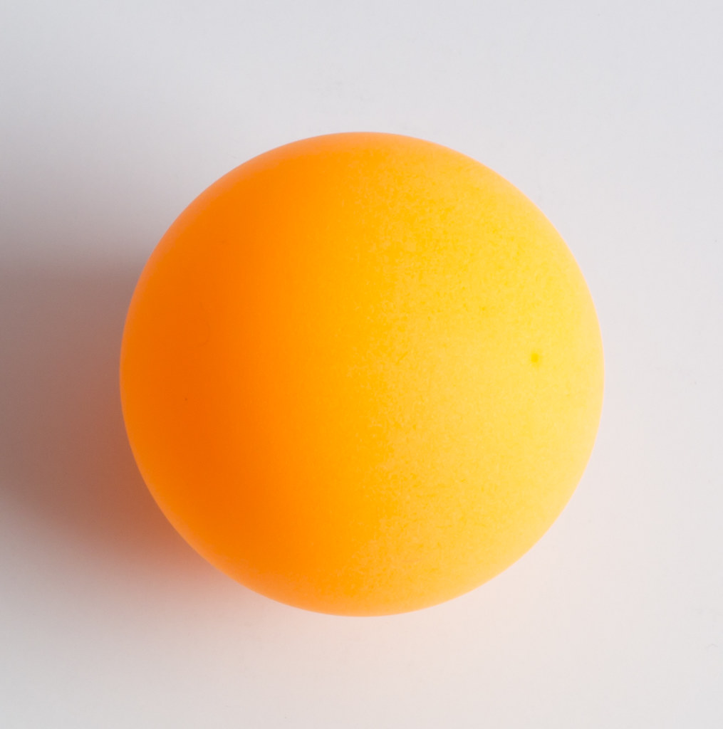 Orange ping pong ball close up feel free to use this - How are ping pong balls made ...