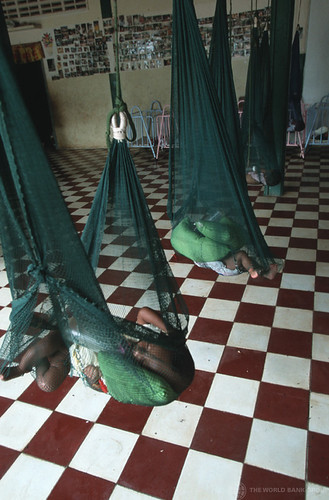 Orphans sleep in beds made from hanging mosquito nets | by World Bank Photo Collection
