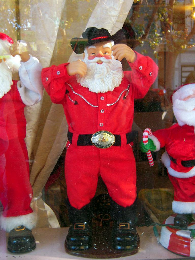 Cowboy santa claus he s one of ten santas in the window