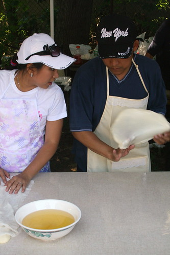 Flipping dough at the Myanmar Baptist Church Fun Fair, Briarwood, Queens | by Eating In Translation