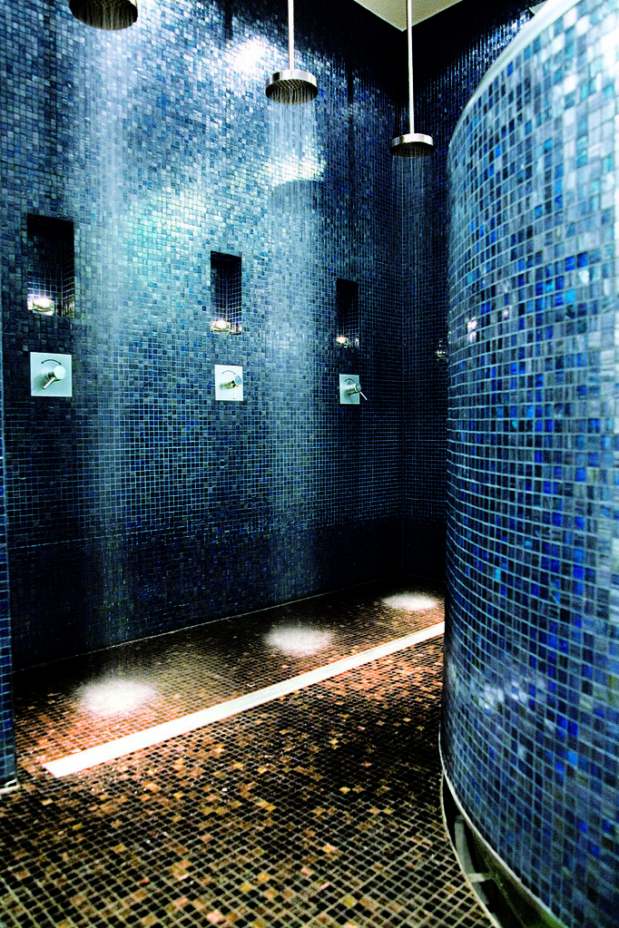 Trendy blue tiles in the welness shower area at the hotel for Trendy bathroom tiles
