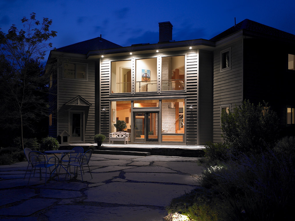Nighttime photo of entry home plan number 37778 lindal for Lindal cedar home plans
