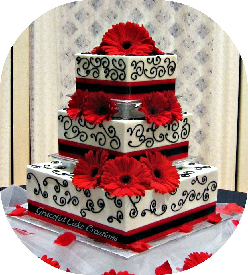 Two Tier Red And White Wedding Cake Roses And Swags