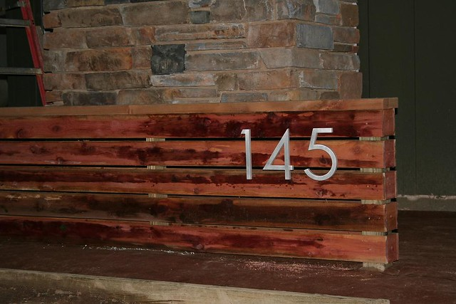 House numbers on fence eastern red cedar with house number