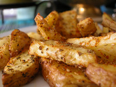 Sesame studded potato wedges | by Nandita Iyer
