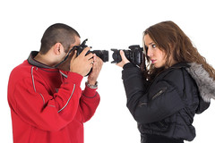 Young man and woman taking pictures of each other | by ralphbijker