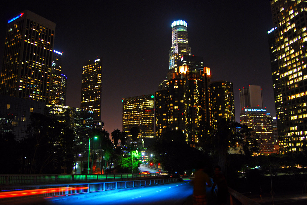 downtown la at night car with blue lights was passing by