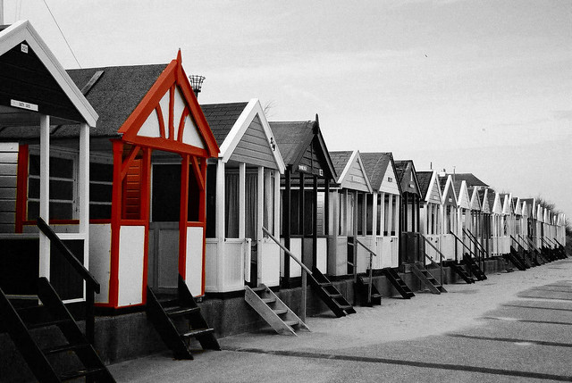 Beach huts in southwold red on black and white by piblet