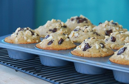 crunchy peanut butter, banana, and chocolate chunk muffins | by Food Blogga