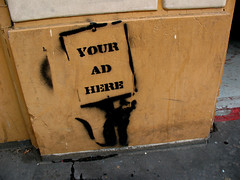 A 'Place Your Ad Here' sign.
