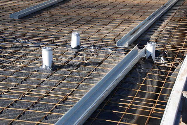 Laying Concrete Slabs : Preparing for concrete slab laying the plastic and wire