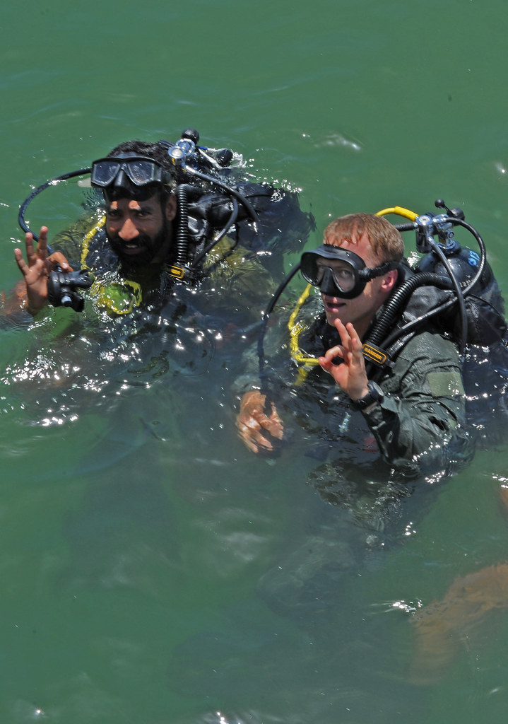 us and pakistan navy divers give an ok signal before condu