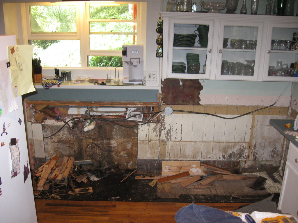 Ouch kitchen water damage the investigation starts to - How to repair water damaged kitchen cabinets ...